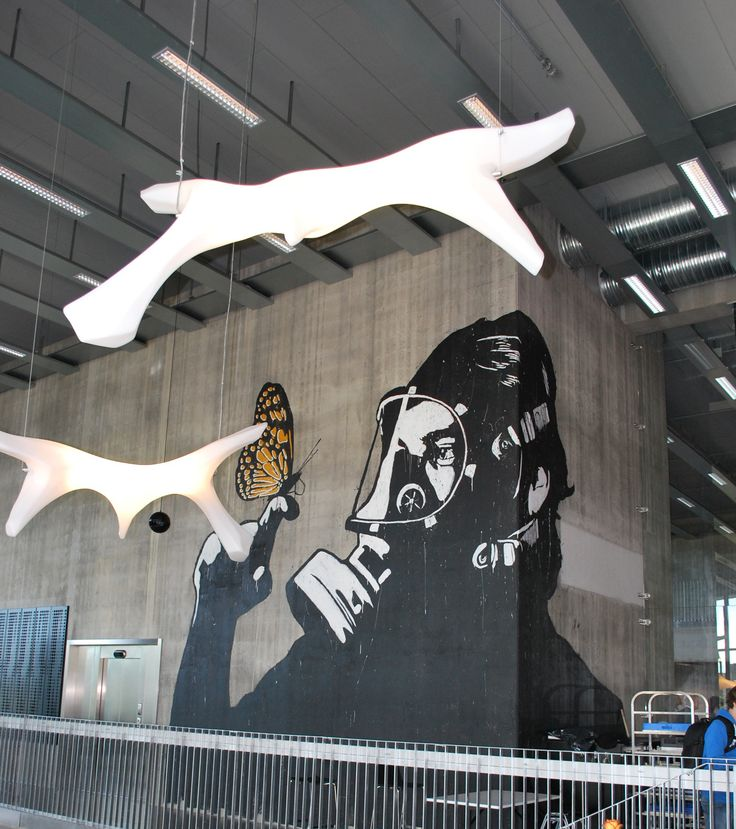 Thor Heyerdahl College in Larvik (Norway) and its dynamic design is intended to create opportunities for academic exploration, knowledge sharing and social interaction right across the student community, as a visual metaphor honouring the ethos of the man after whom the college is named. Art piece on its walls by Banksy. #architecture #art #banksy