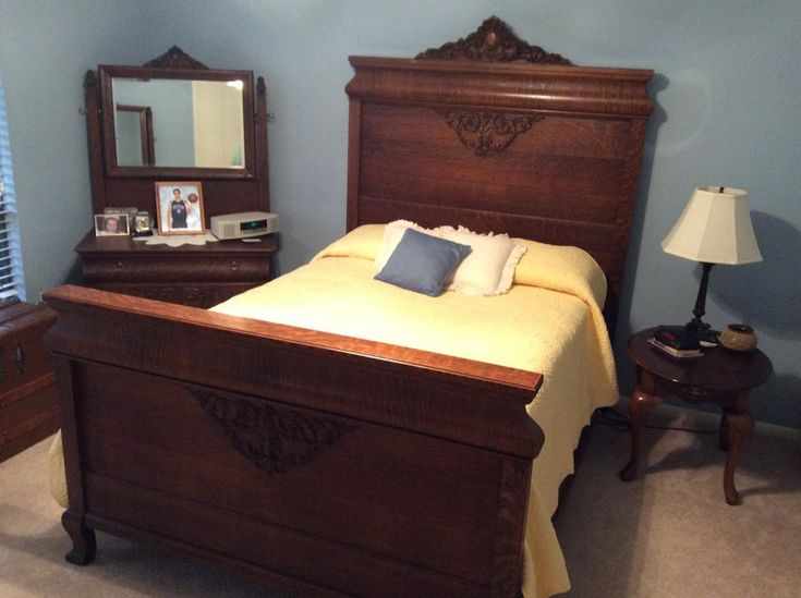 Antique oak bedroom set in great condition.  Never been refinished.  Includes bed (headboard, footboard, and sideboards with slats), small dresser with mirror and large dresser with mirror.