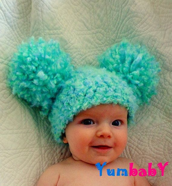 Pom Pom Baby Girl Hat - Super Cute! This is all my imaginary sweet little baby is going to wear until it has hair. At which point, I'm going to dye it's hair this color.