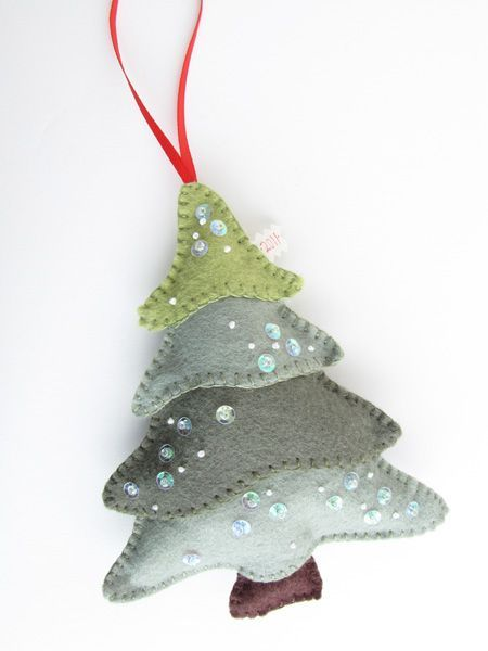 Felt Christmas Tree - Pretty by Hand - Pretty By Hand. [Oh-oh.  I'm seeing a trend here.  It's AUGUST, for heaven's sake, and I'm slipping into a December state of mind - ]