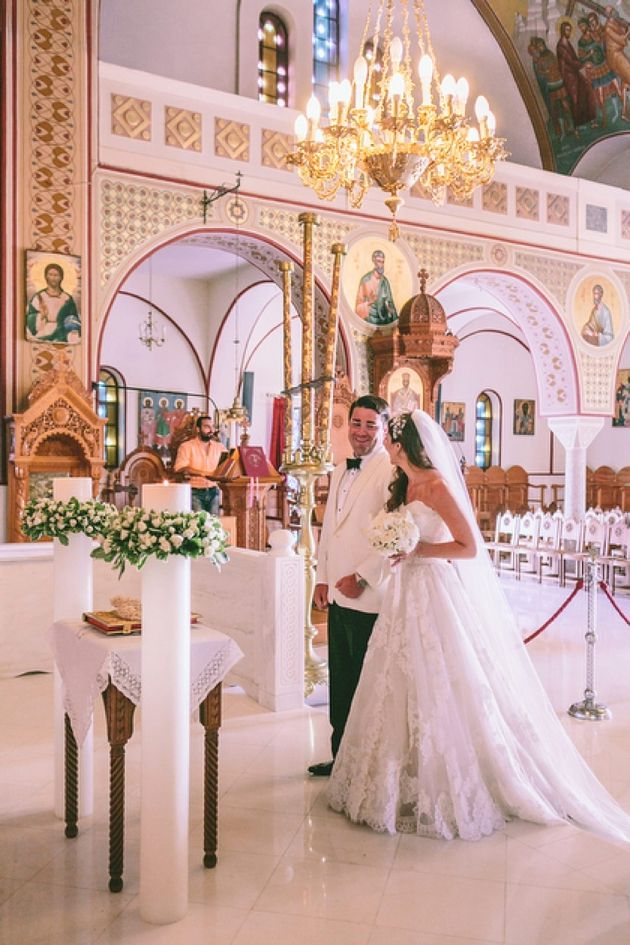 The ceremony took place at the Cathedral Church of Santorini on the cliff-edge overlooking the volcano.  Captured perfectly by George Pahountis.