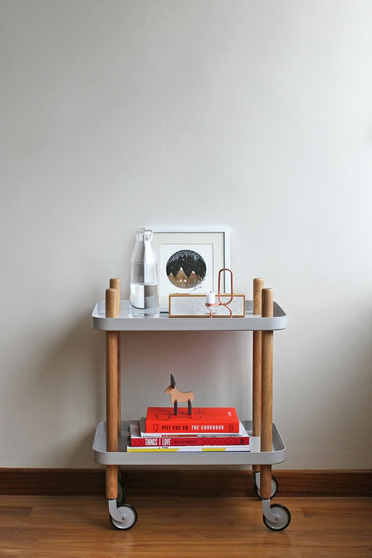 Wheeled side table Normann Copenhagen block table , Hay design candle holder , Lexon digital clock , framed illustration of Natasha Newton