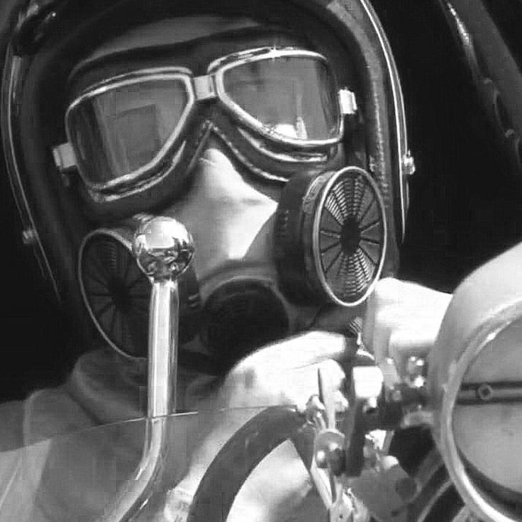 Girl enjoying a fire proof Mask as she warms up the Dragster of her Team Mate