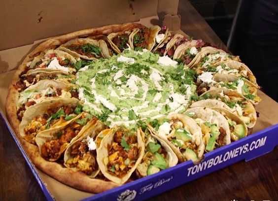 Hope this becomes a trend! Too lazy to make it myself. The Taco Tuesday Pizza Is Topped With Tacos And Guacamole