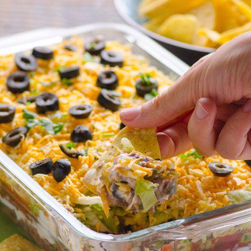 Skinny 7 Layer Dip // Clean Tex Mex Dip featuring black beans, salsa, Greek yogurt and low fat cheese via iFood Real #appetizer
