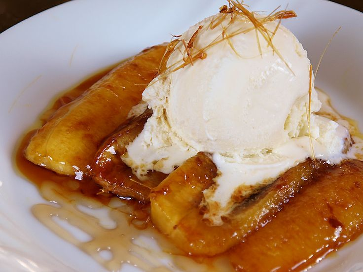 Banana Flambe  Banana Flambé or Bananas Foster is a dessert made out of bananas and vanilla ice cream in a thick sauce made out of butter, sugar and rhum.