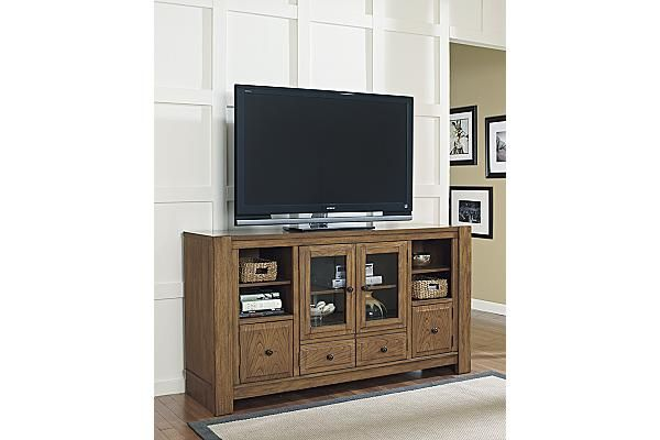 """The Birnalla 72"""" TV Stand from Ashley Furniture HomeStore (AFHS.com). The """"Birnalla"""" TV stand takes a warm woody brown finish that perfectly complements the bronze color of the wrought looking hardware adorning the rustic detailed raised panel doors to create the perfect Vintage Casual design."""