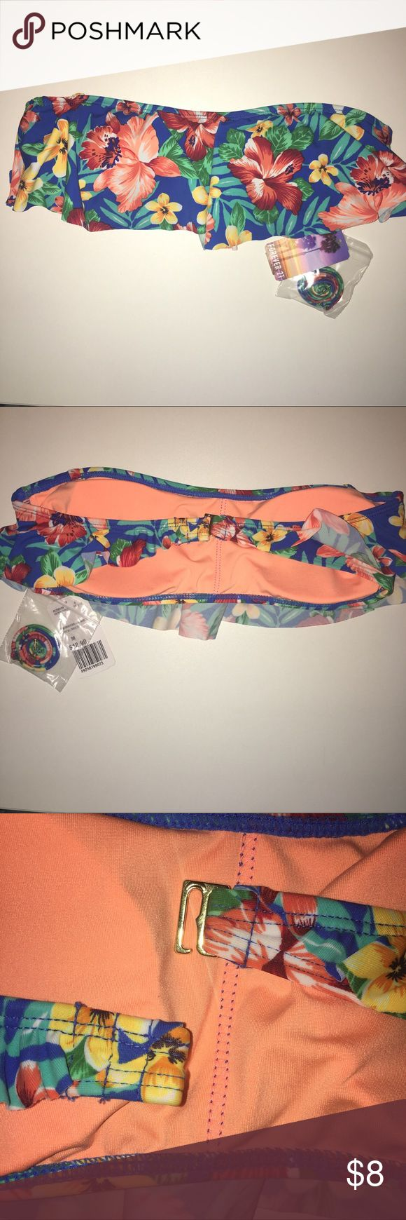 Price drop!! NWT floral bikini top NWT Hawaiian floral bandeau bikini top from Forever 21. Includes strap and removable padding. Hook closure. Royal with floral design. Size M.  ✨✨✨  Never worn. Bright colors would pair well with any solid color bikini bottom!   Firm price. Forever 21 Swim Bikinis