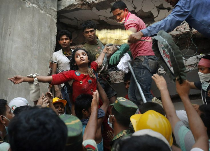 Horror in Bangladesh | A Bangladeshi woman survivor is lifted out of the rubble by rescuers on Thursday, April 25, 2013, at the site of a building that collapsed Wednesday in Savar, near Dhaka, Bangladesh. | Photo: AP / Kevin Frayer