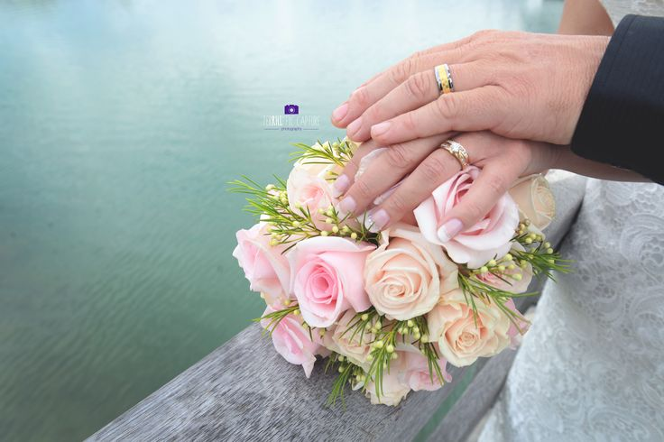 Beautiful vintage pink rose wedding bouquet. Gold rings on the water. TerRHIffic Capture Photography
