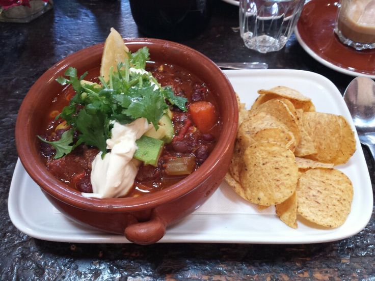 Mexican Yucatan spiced beans with avocado, corn chips, lime and sour cream