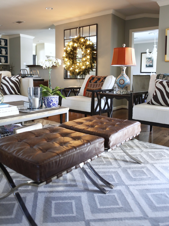 What don't I love about this room? Zebra pillows, PB Mirror, lighted wreath, wall color, dark floors, bright lamp!