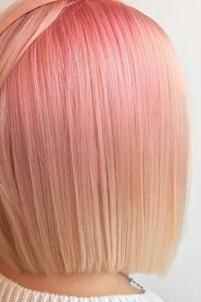 """Stylist Presley Poecalls this color """"Butter'd Rose Gold"""" due to its blend of slightly metallic pink and yellowy-blonde tones. """"For this color, I blended the current fade from her previous color [a bright pink] with the pink melt at the base,"""" Poe toldAllure.The result is a lived-in, wearable version of rose."""