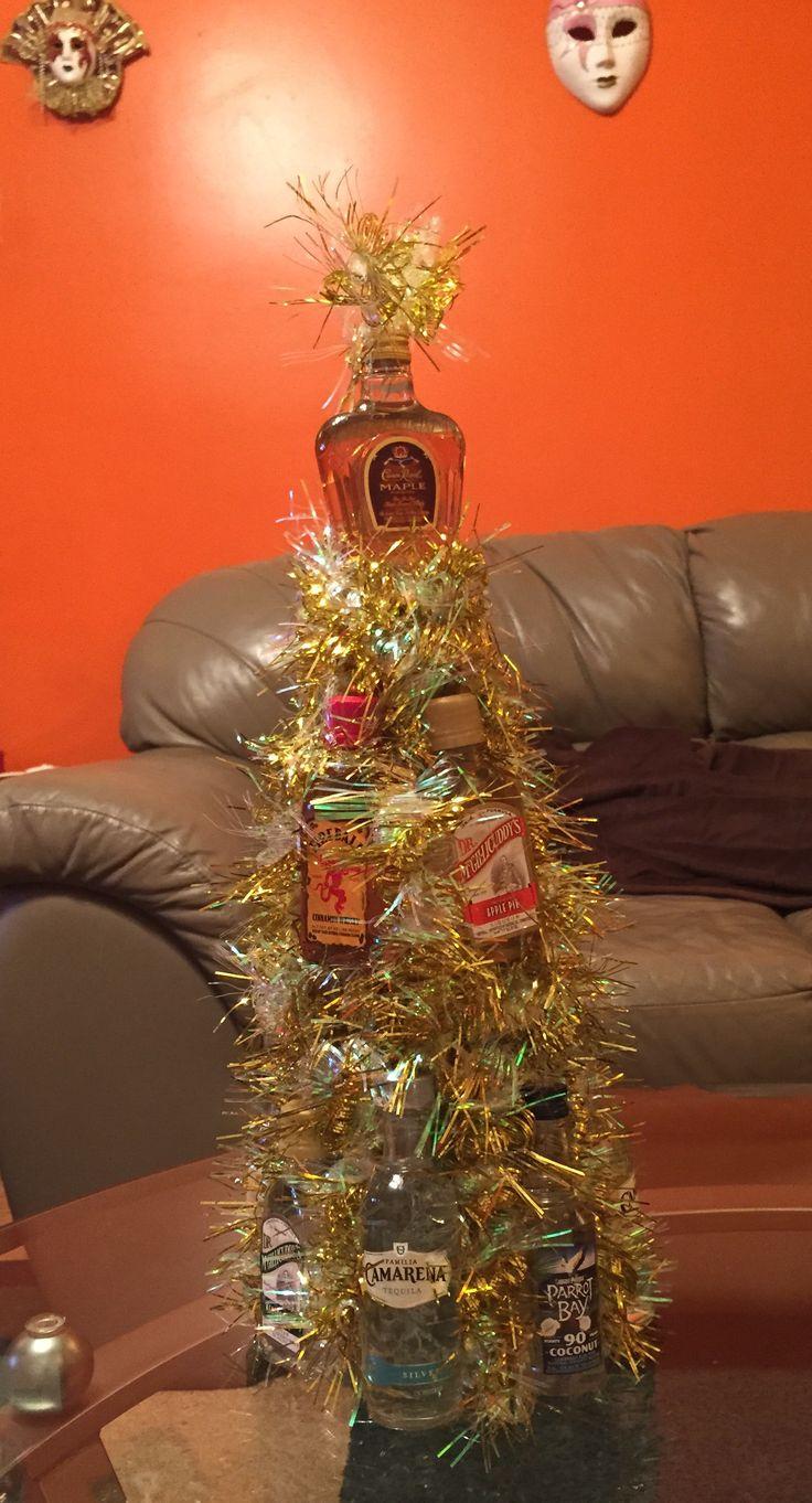Nip Christmas Tree! Great for Yankee Swaps! 13 nips, 1 styrofoam cone, garland, & hot glue. Great gift idea for $20 dollars!!