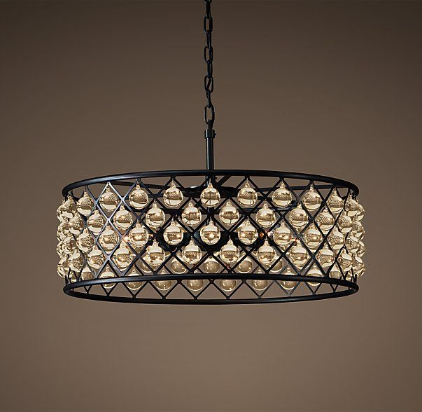 """CHANDELIER 32"""" - NOW IN STORE   An inspired design from the British workshop of Timothy Oulton, our Spencer lighting collection's crystal glass spheres hang like gems within its iron grid.  DIMENSIONS Overall: 31½"""" diam., x 18""""H Weight: 65.4 lbs."""