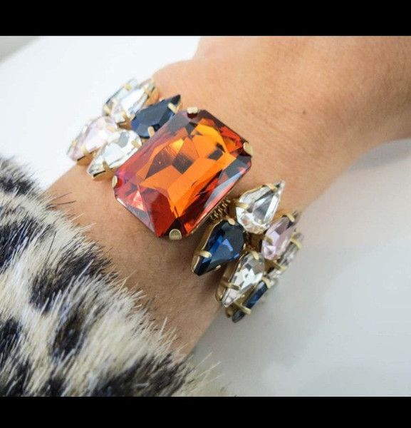 Thorner Bracelethe Thorner bracelet features 13 handset swarovski crystals. The orange and navy combo is striking yet subtle and as much as we love a good arm stack, we are so feeling this solo. Glams up any outfit. Ell and Emm.