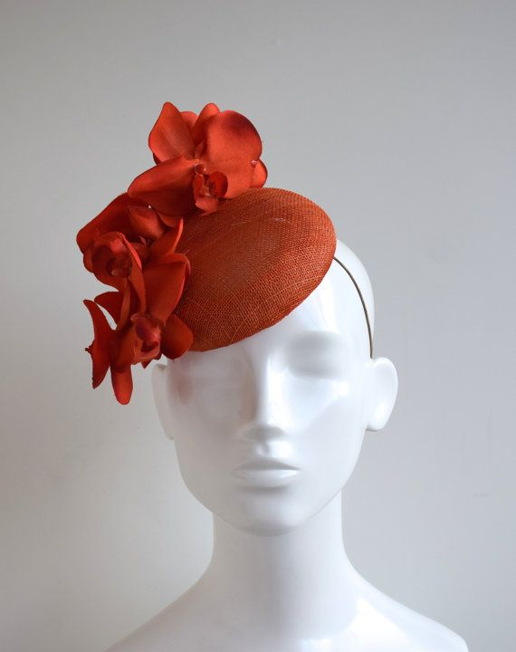 Check out this item in my Etsy shop https://www.etsy.com/uk/listing/493955078/orange-button-hat-orange-fascinator