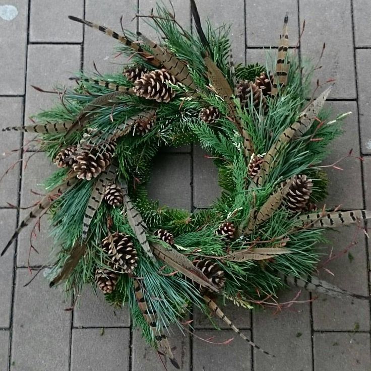 Another cool feather wreath idea, here pheasant feathers combined with pine cones and evergreens
