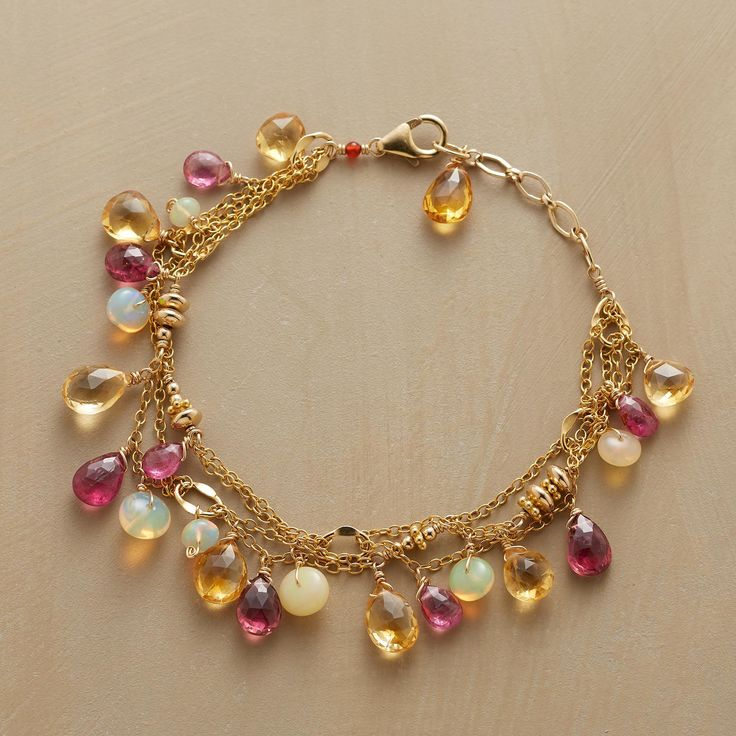 "LOVELY LINKED BRACELET -- Linked 14kt goldfill strands dangle faceted pink tourmalines and citrines amid smooth opals. Exclusive. Handmade in USA by Thoi Vo. Lobster clasp. 7"" to 8-1/4""L."
