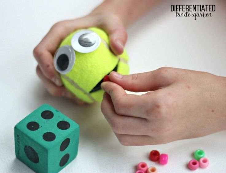 This simple tennis ball monster makes fine motor and math work a perfect match.