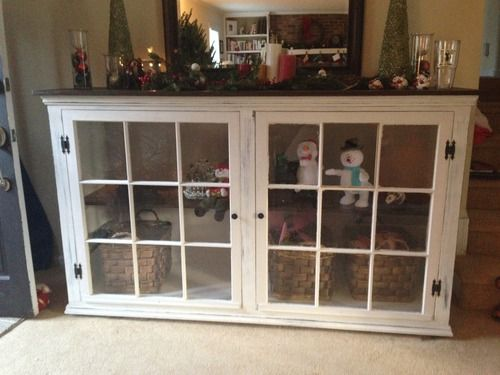repurposed old windows into a distressed cabinet.