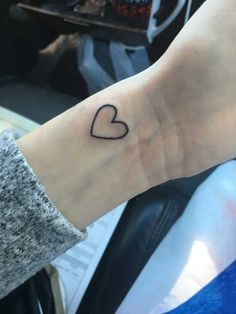 Ah the heart. Definitely one of the most popular tattoo designs year in and year out. This simple minimalistic outline may be small but it represents humankind's strongest emotions — love and affection
