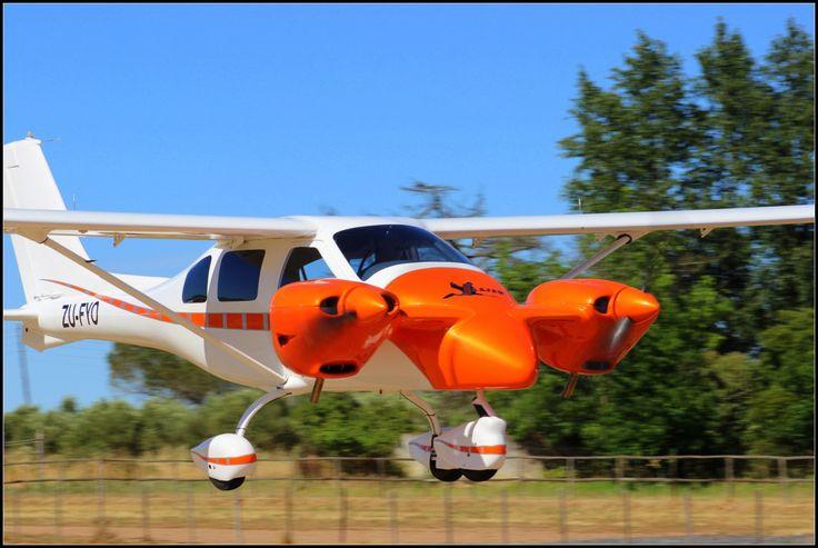 Jabiru J432 Twin Aircraft painted in a hot metallic orange. Fling in Cape Town South Africa 2016