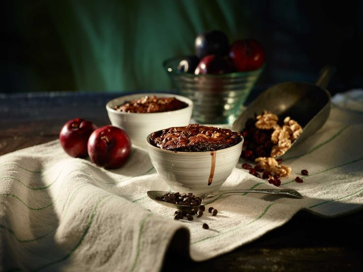 Indulge yourself with a walnut and cranberry chocolate pudding that is made with a delicious cocoa sauce.