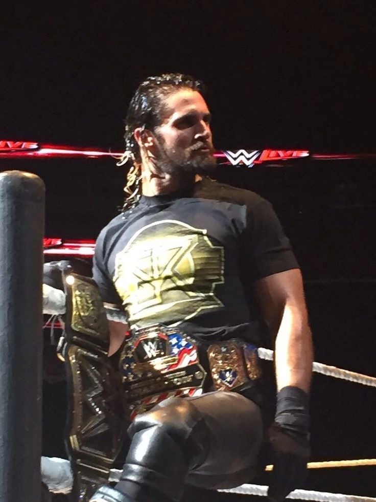 Seth Rollins with his United State and WWE World Heavyweight Championships