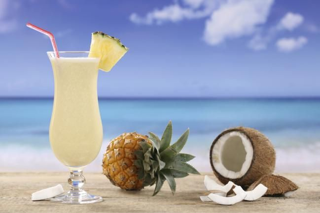 FABULOUS PIÑA COLADA DRINK! ¼ cup/2 oz. Captain Morgan Parrot Bay Rum; ¼ cup/2 oz. Coco Lopez CREAM OF COCONUT  (NOT coconut milk); ½ cup/4 oz. Pineapple Juice; 2 cups Ice. Place all ingredients into a blender and blend thoroughly until smooth. Pour into tulip shaped serving glass, top with a straw, umbrella and a piece of pineapple. Enjoy!