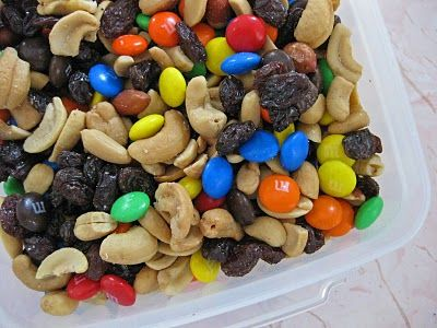 Trail Mix  2 cups high-fiber cereal, such as Wheat Chex  2 cups mini-pretzels or whole grain Goldfish crackers  1/2 cup raisins or dried fruit  1/2 cup unsalted mixed nuts  1/4 cup of M candies  Blend all ingredients in a bowl and divide into 2/3-cup portions.  Place mix into zip-top plastic snack bags.  Makes eight servings.