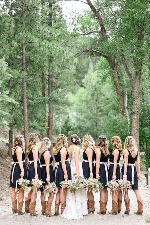 Country wedding ideas: black bridesmaid dresses and brown leather boots.