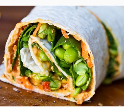 Easy Hummus Spiral Wraps -- roasted red pepper hummus, spinach, carrots, edamame, and avocado