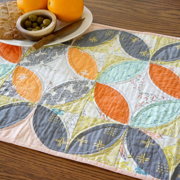 A Free Quilts project from Sharon Holland Designs, the Orange Peel table runner.