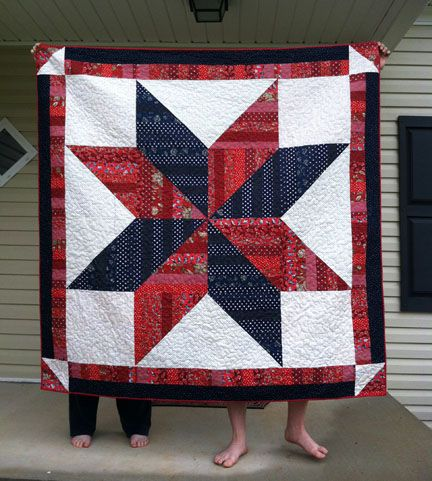 Hunters Star Quilt.  What a bold looking quilt.  I love the color choices the quilter used.  I think the corner half square triangles really set this quilt off.