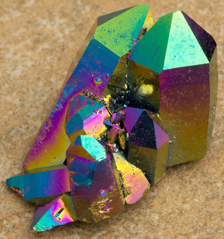 Aura Crystals™ Rainbow Clusters are natural Quartz that are permanently bonded with Titanium and Oxygen. The crystals change and give off the different colors as light reflects off of them. Type: Aura