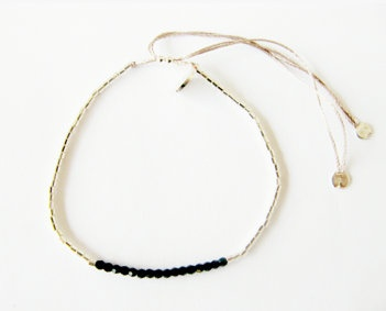 Silver beaded bracelet: Sterling silver beaded bracelet ith black Swarovski crystals in the center on 100% silk thread.  Size adjustable, sterling silver finishes.  $70