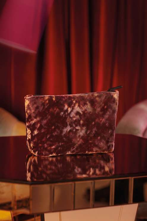 Keep your make-up essentials stored stylishly in this pink tent-shaped crushed velvet make-up bag with black zip-top. #Topshop