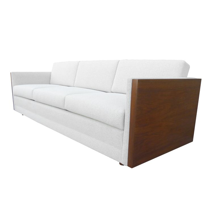 Walnut Tuexedo Sofa Att. to Milo Baughman  USA  1960s  This classic 1960s three seat tuxedo sofa designed by Milo Baughman features square outer arms finished in walnut. The piece has been newly reupholstered in ivory boucle which also pads the inner arms creating a comfortable yet chic seating solution. The sofa rests on cylindrical walnut legs.