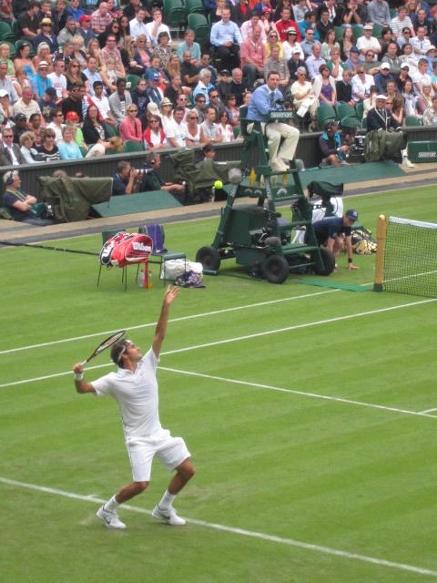 Wimbledon, England.  Roger Federer serving.
