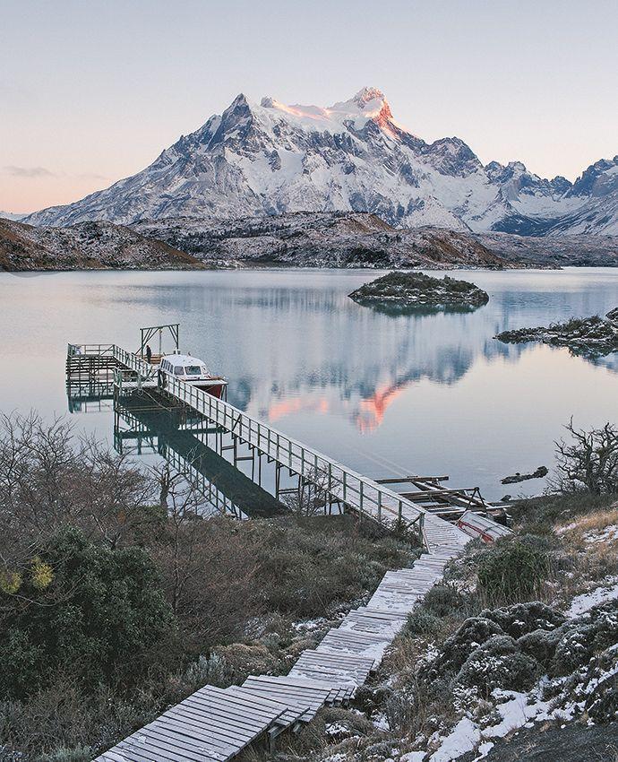 The sun rises over the Torres del Paine range. Read our full feature on training and hiking with #Chile's top guides at in #Patagonia: http://enroute.aircanada.com/en/articles/explora-patagonia-school // Le soleil se lève sur le massif Torres del Paine.  L'article complet sur notre voyage au bout du monde avec les meilleurs guide du Chili, en #Patagonie: http://enroute.aircanada.com/fr/articles/l-ecole-au-bout-du-monde