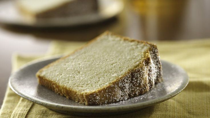 Enjoy this delicious pound cake sprinkled with powdered sugar - perfect for a dessert.