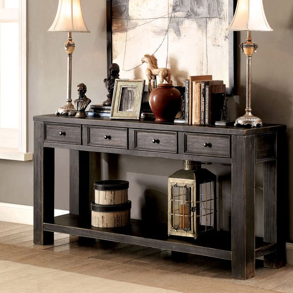Add long-lasting designs to your home with the help of this bold antique black sofa table. The wide design is braced upon straight legs while a spacious bottom shelf keeps items off the floor. Set inc
