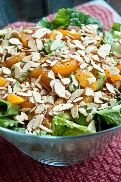 Romaine lettuce, green onions, mandarins, avo, slivered almonds and Parmesan cheese.   The dressing - extra virgin olive oil, apple cider vinegar, brown sugar and salt. Yum!