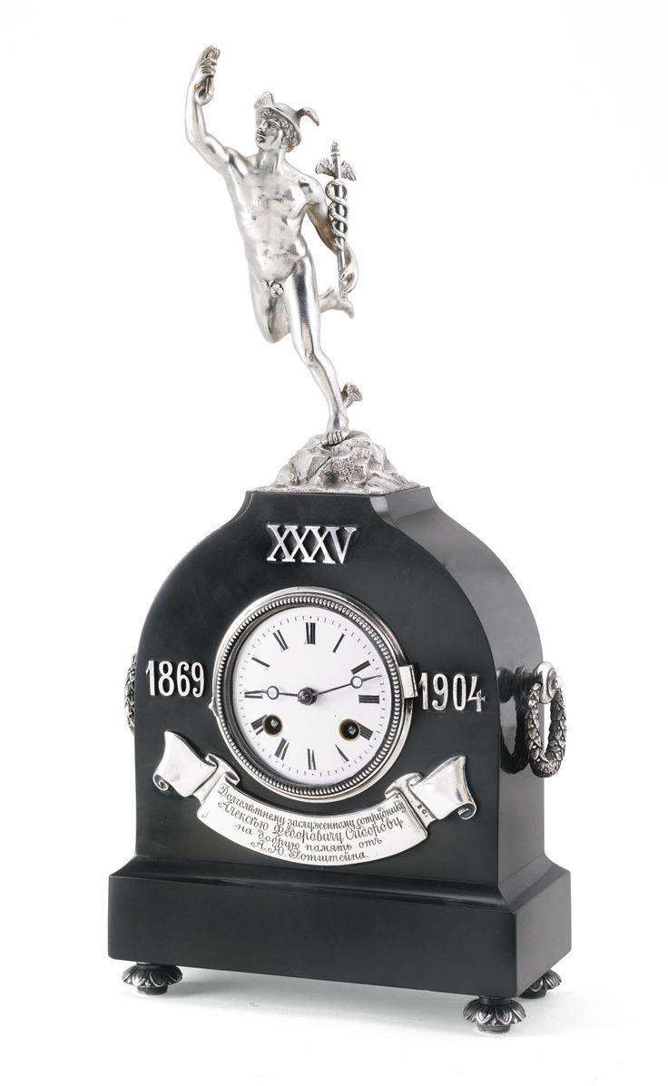 A FABERGÉ SILVER AND HARDSTONE FIGURAL CLOCK, WORKMASTER JULIUS RAPPOPORT, ST PETERSBURG, 1908-1917