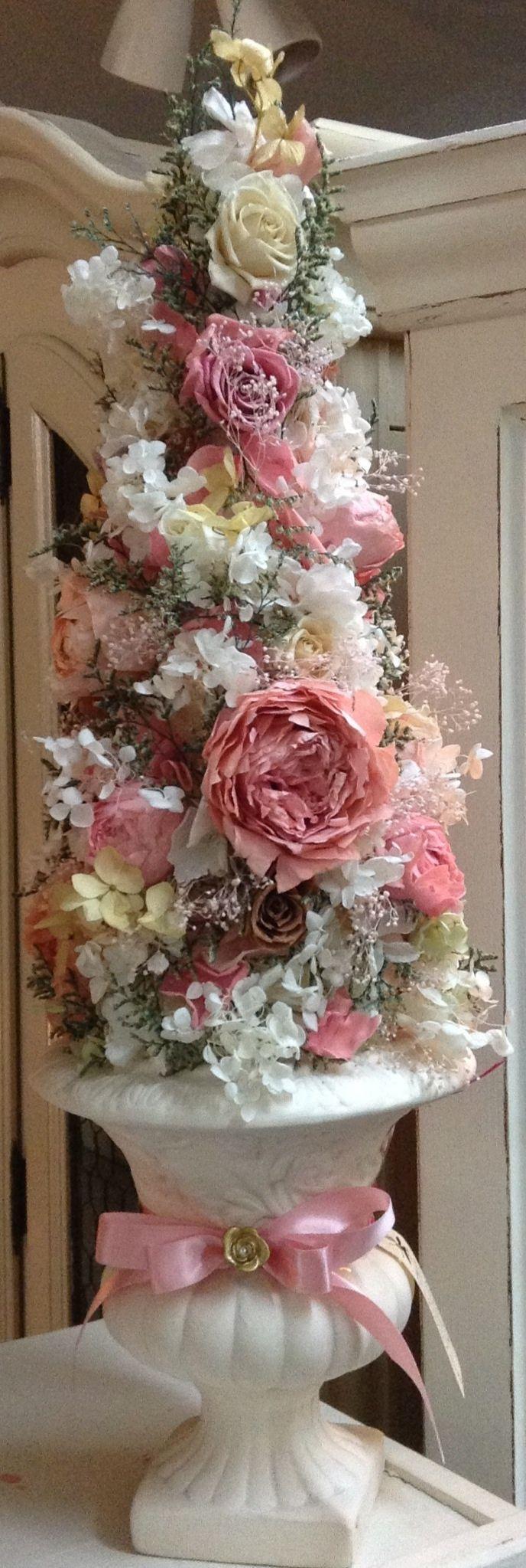 "Soooo beautiful! A topiary Christmas ""tree"" made of English roses, baby's…"