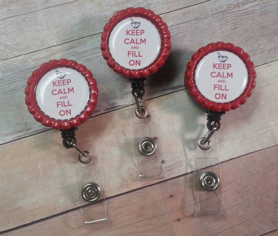 This listing is for ONE (1) Retractable Badge Reel. Bottle cap colors may vary but image will remain the same. These badge reels feature a clip on the back to fasten to shirts or lanyards, and have a snap closure to secure badges and IDs. The reel pulls out to approx. 24 Please message me for additional quantities or custom bottle cap images.