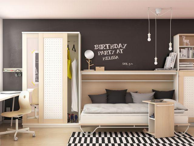 Chambre au style moderne avec suspensions déco et un petit bureau aménagé