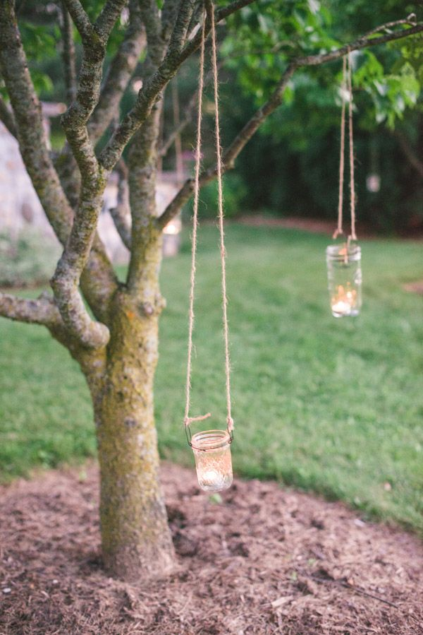 hang tea lights in mason jars at your venue to create a romantic ambiance #masonjardiy #weddinglighting #weddingchicks http://www.weddingchicks.com/2014/01/24/pinterest-inspired-vintage-wedding/