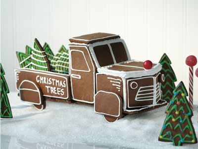 Gingerbread truck filled with Christmas trees.